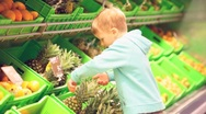 Little boy with pineapple Stock Footage