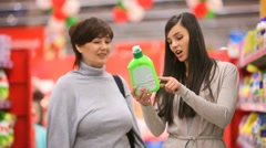 Mother and daughter in supermarket - stock footage