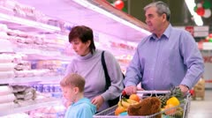 Family in mall near refrigerators Stock Footage