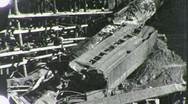 Stock Video Footage of DERAILED Train Wreck Boxcars on Bridge 1930s (Vintage Film Home Movie) 1860