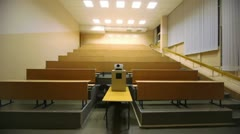 Light turned off, and then switched on, in empty lecture auditorium Stock Footage