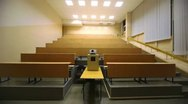 Stock Video Footage of Light turned off, and then switched on, in empty lecture auditorium