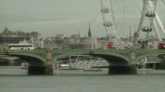 HD London Bus Crosses Bridge London Eye Stock Footage