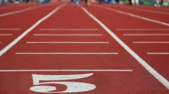 Running track number five with special red cover for racing Stock Footage