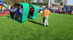 Two team  inside inflated cloth chase each other, competition Great Race 2010 Stock Footage