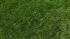 Green artificial grass of soccer field, part of gate for soccer with net Stock Footage