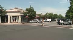 Person walking across intersection on crosswalk Stock Footage