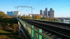 Train passes by on railway bridge Stock Footage