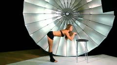 Model make active movements by her legs in photo studio Stock Footage