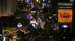 The Mirage hotel and Harrah's on the Las Vegas strip at night Stock Footage