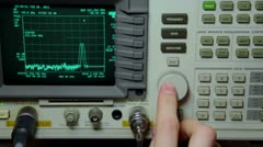 Hand push buttons and rotates knob on oscilloscope for old video repair - stock footage