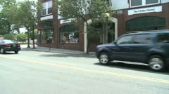 Cars coming to stop sign at intersection Stock Footage