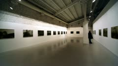 Few people at photography exhibition Stock Footage