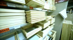 Several wooden frames are on shelves in store Stock Footage
