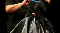 Hairdresser makes hairdo for black hair model Stock Footage