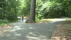 People walking and riding bikes in park (2 of 3)Town Tour (x of x) Stock Footage