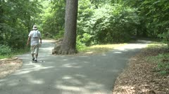 People walking and riding bikes in park (3 of 3) Stock Footage