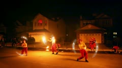 Three men spin poi at fire show performance Stock Footage