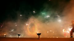 Man spin poi at fire show performance Stock Footage