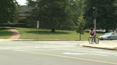 Biker waiting for light at intersection Stock Footage