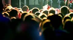Lot of people applaud on concert - stock footage