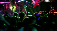 Many people applaud on concert, view from behind - stock footage