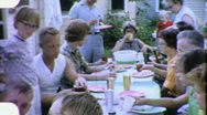 Stock Video Footage of Family Reunion Meal Lunch Picnic 4th of July 1960s Vintage Home Movie 1877