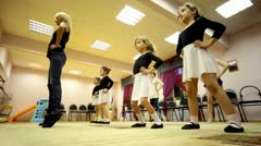 Girls squat at training with ballet teacher Zharova Svetlana Stock Footage