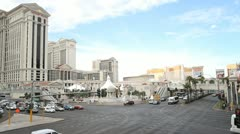 Caesars Palace and a busy junction on the Las Vegas strip Stock Footage