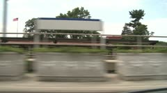 Riding by train station Stock Footage