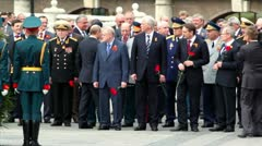 Prime minister of Russia V.Putin walk and greets political leaders and military Stock Footage