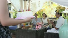 Young people with cake taking pictures at birthday party Stock Footage