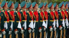 Soldiers stay in row and rises rifles on wreath laying ceremony Stock Footage