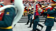 Interior Ministry officials salute, military orchestra play and march Stock Footage
