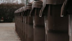 Garbage Cans Lined up Stock Footage