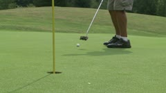Male golfer making a 5 foot putt - stock footage