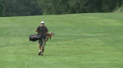 Golfer walks the fairway Stock Footage
