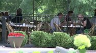 Stock Video Footage of Tables overlooking woods at a small out side restaurant