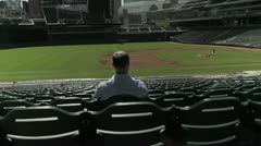 Man in Empty Baseball Stands Stock Footage