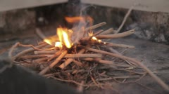 Small Camofire with Kindling Stock Footage