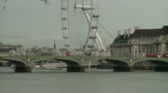 HD London Bus Crosses Bridge London Eye 2 Stock Footage