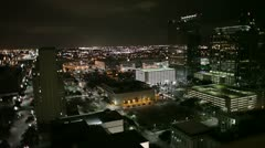 Downtown night scene from rooftop Stock Footage
