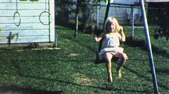 Little Blonde Girl on Swing Playset 1960s Vintage Film Home Movie 1894 Stock Footage
