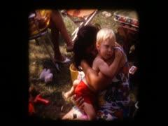 Cute blonde baby boy hugs mom Stock Footage