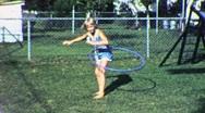 Happy Little Girl Blond Hula Hoop Exercise Fun 60s Vintage Film Home Movie 1896 Stock Footage