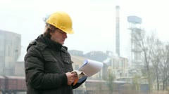 Engineer with Hard Helmet and Clipboard Stock Footage