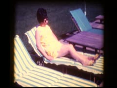 70's woman lounge chair poolside Stock Footage