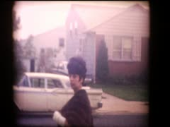 Stock Video Footage of 60's mom dressed for formal affair