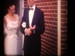Stock Video Footage of 60's couple leaving for formal affair