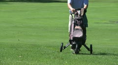 Man wheeling his golf clubs between holes (3 of 3) Stock Footage